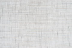 Natural white linen texture. Finely dispersed bluish and ocher threads Royalty Free Stock Photos