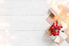 Natural white wooden background with gift box royalty free stock images