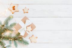 Natural white wooden background with spruce brunches and gift stock photography