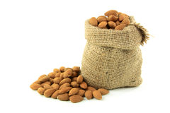 Natural Whole Almonds nuts in burlap bag. Stock Images