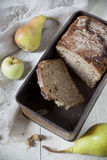 Natural wholemeal sliced bread on vintage box with pears Royalty Free Stock Images