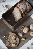 Natural wholemeal sliced bread and walnuts on vintage box Royalty Free Stock Images