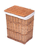 Natural wicker laundry basket. Isolated on white background royalty free stock photo