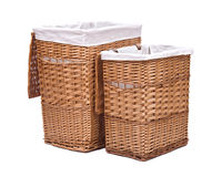 Natural wicker laundry basket. Isolated on white background stock image