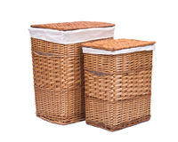 Natural wicker laundry basket. Isolated on white background royalty free stock photography