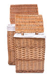 Natural wicker laundry basket. Isolated on white background royalty free stock photos