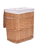 Natural wicker laundry basket. Isolated on white background stock photos