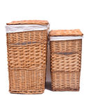 Natural wicker laundry basket. Isolated on white background stock images