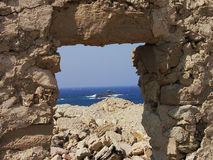 Natural window. On the sea in Mykonos, Greece royalty free stock photography