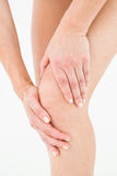 Natural woman touching her painful knee Royalty Free Stock Photo