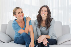 Natural women posing while sitting on the couch Stock Images