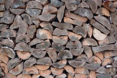 Natural wood background, close-up. The firewood is laid and prepared for the winter pile of wooden logs. royalty free stock photo