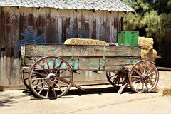 Wagon, antique in the desert in Queen Creek, Arizona, United States. Natural wood with blue-green paint antique wagon, located in the desert in Queen Creek royalty free stock photos