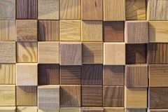 Wooden cubes background. Natural wood cubes squares wall background royalty free stock image