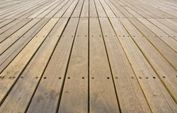 Natural wood floor panels in a park. Royalty Free Stock Image