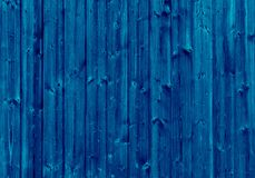 Natural wood painted with semi transparent dark blue paint Royalty Free Stock Image