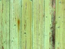 Natural wood texture with green flaked paint Stock Photos