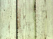 Natural wood texture with yellow flaked paint Royalty Free Stock Photos