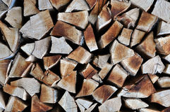Natural wooden background, chopped firewood. Firewood stacked fo Royalty Free Stock Photo