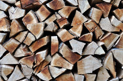 Natural wooden background, chopped firewood. Firewood stacked an Royalty Free Stock Photo