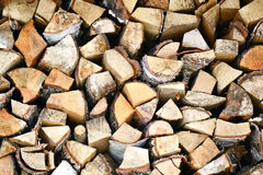 Natural wooden background, closeup of chopped firewood. Firewood stacked and prepared for winter Pile of wood logs Stock Images