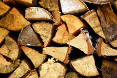 Natural wooden background, closeup of chopped firewood. Firewood stacked and prepared for winter Pile of wood logs Stock Photography