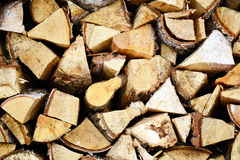 Natural wooden background, closeup of chopped firewood. Firewood stacked and prepared for winter Pile of wood logs Stock Image