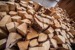 Natural wooden background, closeup of chopped firewood. Firewood stacked and prepared for winter Pile of wood logs. Royalty Free Stock Photo