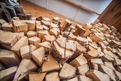 Natural wooden background, closeup of chopped firewood. Firewood stacked and prepared for winter Pile of wood logs. Stock Photos