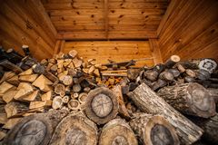 Natural wooden background, closeup of chopped firewood. Firewood stacked and prepared for winter Pile of wood logs. Royalty Free Stock Photos