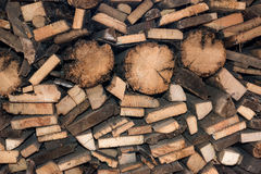 Natural wooden background, closeup of chopped firewood. Pile of wood logs. Stock Image