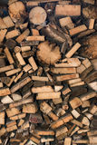 Natural wooden background, closeup of chopped firewood. Pile of wood logs. Stock Photos
