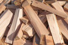 Natural wooden background, closeup of chopped firewood. Chopped firewood on a stack Royalty Free Stock Photo