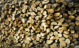 Natural wooden background - closeup of chopped firewood. Firewood stacked and prepared for winter Pile of wood logs Stock Image