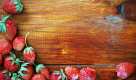 Natural wooden background with fresh strawberries in a corner Royalty Free Stock Photo