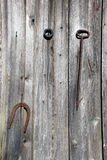 Natural wooden backgrounds. Gaff and horseshoe to the wooden plank wall royalty free stock photo
