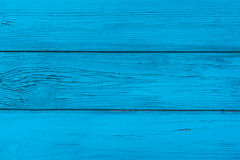 Natural wooden blue boards, wall or fence with knots royalty free stock image