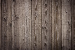 Natural wooden brown boards, wall or fence with knots. Abstract texture background, empty template Royalty Free Stock Photo