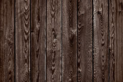 Natural wooden brown and chocolate boards, wall or fence. With knots. Abstract texture background, empty template royalty free stock photos