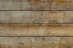 Natural wooden brown and rusty boards, wall or fence with knots Royalty Free Stock Images