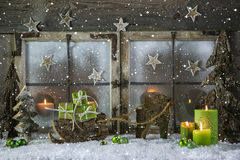 Natural wooden christmas decoration with candles and green prese Royalty Free Stock Photos