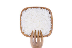 Natural Wooden fork with rice in small wooden bowl Royalty Free Stock Photography