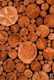 Natural wooden logs cut and stacked in pile, felled by the logging timber industry,. Abstract photo of a pile of natural wooden logs background royalty free stock photography