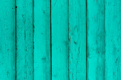 Natural wooden mint boards, wall or fence with knots. Painted turquoise wooden vertical planks. Abstract textured background, empty template stock image