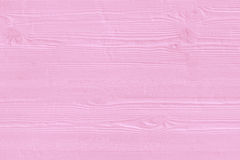 Natural wooden pink boards, wall or fence with knots Stock Images