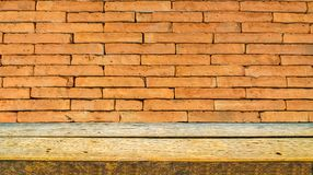 wooden shelf and orange brick wall stock photos