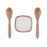 Natural Wooden spoon with rice in small wooden bowl Stock Images