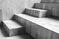 Natural wooden stairs. Black and white photo. Abstract empty interior fragment, natural wooden stairs. Black and white photo with selective focus Stock Photography