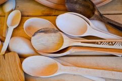 Natural wooden traditional kitchen appliances, dishes, spoons, shovels. The background.  stock images