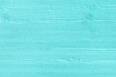 Natural wooden turquoise boards, wall or fence with knots. Abstract textured mint background, empty template royalty free stock photo
